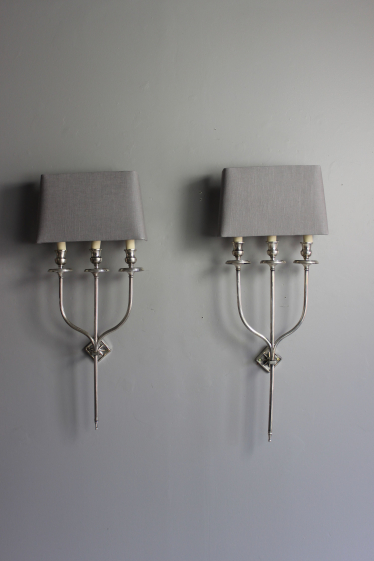 A smart pair of silver plate  wall sconces